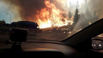 Wildfires on Highway 63 southbound as residents of Fort McMurray leave the downtown area on Tuesday May 3, 2016. (Robert Murray photo)