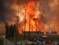 Flames rise in the industrial area south of Fort McMurray May 3, 2016. (Courtesy CBC News/Handout via REUTERS)
