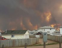 An evacuation order has been given to residents in several neighbourhoods around Fort McMurray, Alta., as flames from a growing wildfire threaten the city. (Mary Sexsmith)
