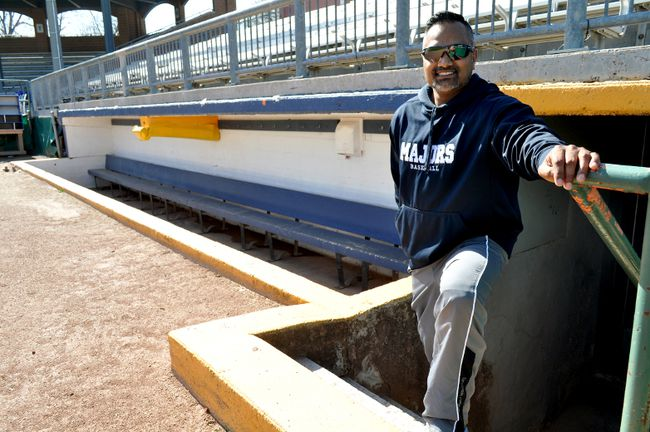 London Majors manager Roop Chanderdat stands next to the dugout at Labatt Park in London Ont. April 27, 2016. (CHRIS MONTANINI, Postmedia Network)