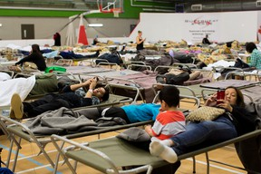 Fort McMurray residents rest at a community centre in Anzac, Alberta, after residents were ordered to be evacuated due to a raging wildfire, May 4, 2016. REUTERS/Topher Seguin