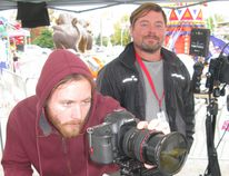 Matthew Braun (left), director of photography for the cable TV show Carnival Eats, and director Spencer Ramsay film a segment for the show at the Norfolk County Fair last October.The segment will air May 14. (File Photo)