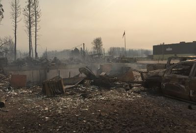 The home of Alberta Wildrose Party Leader Brian Jean is shown burned to the ground in Fort McMurray, Alta., Wednesday, May 4, 2016. THE CANADIAN PRESS/HO-Brian Jean