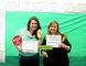 Kathlene Campbell-Conlon, volunteer coordinator with CMHA Oxford (left), and Mandy Van Egdom with the Oxford Self Help Network (right) take a turn in the photo booth station at the CMHA Oxford open house on Wednesday, May 4, 2016. (MEGAN STACEY/Sentinel-Review)