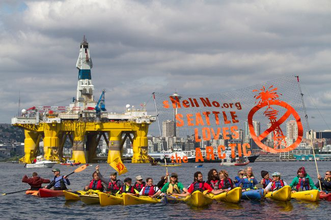 Activists form a kayak flotilla to surround an oil drilling rig near Seattle last year. A similar protest targeting Kinder Morgan is being organized for May 14. 