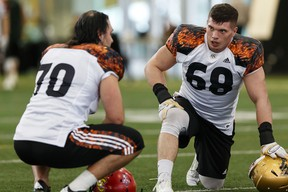 DJ Lalama from University of Manitoba (right) takes a breather during the CFL Regional Combine held at Commonwealth Recreation Centre in Edmonton, Alta., on Monday March 7, 2016. (Photo by Ian Kucerak)