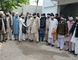 Members of a tribal council accused of ordering the burning death of a 16-year-old girl are shown to the media after they were arrested by police in Donga Gali, outside Abbottabad, Pakistan, on May 5, 2016. (REUTERS/Online News)
