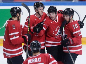 Canada's Matt Duchene, second right, celebrates with teammates after scoring against the Czech Republic in Prague Tuesday, May 3, 2016. (THE CANADIAN PRESS/AP/Petr David Josek)