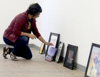 Niki Sangra, creative operations manager, lines up artwork in the order it will be hung on the wall while organizing the pieces in the Teen Art Show 2016 at the Centre for Creative Arts on Wednesday May 4, 2016 in Grande Prairie, Alta. The teen art show is one of two exhibits opening at the centre on Friday. Jocelyn Turner/Grande Prairie Daily Herald-Tribune/Postmedia Network