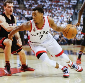 Toronto Raptors guard Kyle Lowry in first half action of Game 2 against the Miami Heat's Goran Dragic at the Air Canada Centre in Toronto on May 5, 2016. (Stan Behal/Toronto Sun/Postmedia Network)