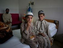 Pakistani children Abdul Rasheed, 9, left, and Shoaib Ahmed, 13, sit in a room during the day at a hospital in Islamabad, Pakistan, on May 6, 2016. The boys are normal active children during the day. But once the sun goes down, they both lapse into a vegetative state — unable to move or talk. Dr. Javed Akram, told The Associated Press on Thursday that he had no idea what was causing the symptoms. (AP Photo/B.K. Bangash)