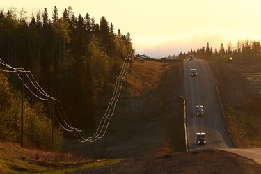 A convoy of cars sporadically heads South down Highway 63 after being stranded at a work camp north of Fort McMurray, Alberta on May 6, 2016. (COLE BURSTON/AFP/Getty Images)