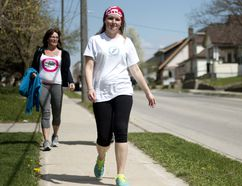 Jenn Miller walks down Canterbury Street in Ingersoll on the fourth day of her journey from London to Ottawa. She is walking to raise awareness and funds for diabetes and meet with the Canadian Minister of Health Jane Philpott. (BRUCE CHESSELL, Sentinel-Review)