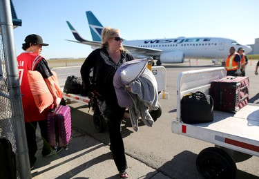 Lillian Coleman is one of the many evacuees that were stranded in camps around Fort McMurray and was flown by WestJet into Calgary, Alta., on Friday May 6, 2016. Leah Hennel/Postmedia