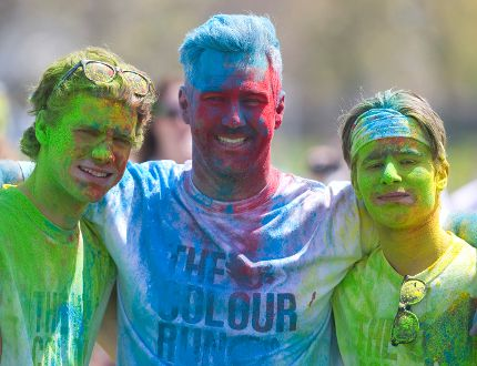 As a fun end to Mental Health Week at Oakridge Secondary School, a colour run got the students and teachers loaded with the Oaks colours of Red, Blue and Gold as they got their laps in on the track in London, Ont. on Friday May 6, 2016. Mike Darling, the athletic director for the Oaks, grabbed Jacob English,16 and Dallas Loiselle, 16 for a post run photo. (Mike Hensen/The London Free Press/Postmedia Network)