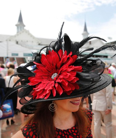 A woman in a derby hat arrives before the 142nd running of the Kentucky Derby at Churchill Downs, May 7, 2016. (Mark Zerof-USA TODAY Sports)