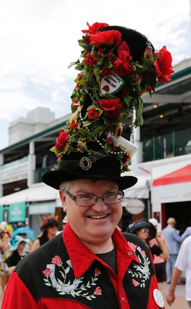 A patron poses for a photo while wearing a decorated derby hat before the 142nd running of the Kentucky Derby at Churchill Downs, May 7, 2016. (Mark Zerof-USA TODAY Sports)