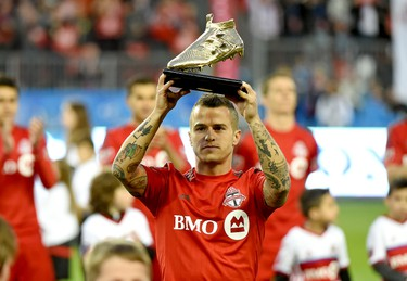 May 7, 2016; Toronto, Ontario, CAN; Toronto FC forward Sebastian Giovinco (10) shows off the Golden Boot award given to him for being leading scorer in the 2015 MLS season prior to kickoff against FC Dallas at BMO Field. Mandatory Credit: Dan Hamilton-USA TODAY Sports