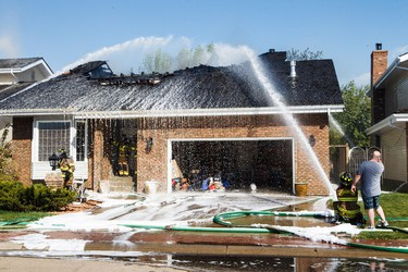 A home at 212 Wolf Ridge Close burns in Edmonton, Alta., on Sunday, May 8, 2016. (CODIE MCLACHLAN PHOTO)