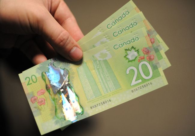 Canadian $20 bills currency money GETTY