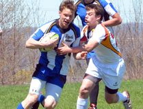 Saugeen District's Eric Langridge is tackled by the OSCVI Falcons Brendan Lumley in the Royals 31-0 win on Monday in Bluewater Athletic Association senior boys rugby action.