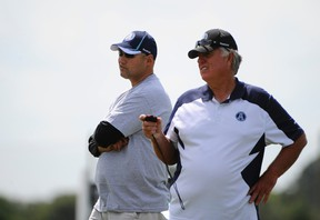 Argonauts head coach Scott Milanovich (left) and general manager Jim Barker have a chance to reload at tonight's CFL draft. (POSTMEDIA NETWORK PHOTO)