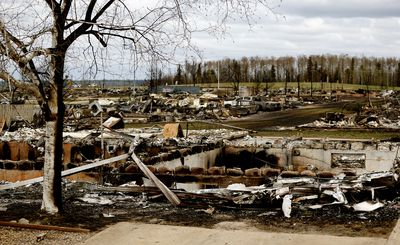 FORT MCMURRAY, ALBERTA: MAY 9, 2016: A fire ravaged Beacon Hill neighborhood in Fort McMurray on May 9, 2016, where a massive wildfire destroyed part of Alberta's fourth largest city and forced the mass evacuation of the total population of 88,000 residents. (PHOTO BY LARRY WONG/POSTMEDIA NETWORK)