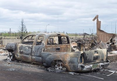 Damage from the wildfires is seen in the Beacon Hill neighbourhood in Fort McMurray, Alta., on Monday, May 9, 2016. THE CANADIAN PRESS/Ryan Remiorz