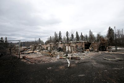 Burned out homes are pictured in the Abasand neighbourhood of Fort McMurray, Alberta, Canada, May 9, 2016 after wildfires forced the evacuation of the town. REUTERS/Chris Wattie
