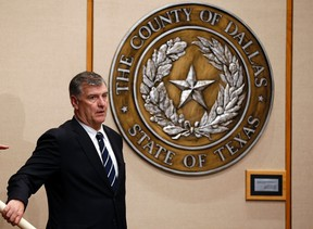 Dallas Mayor Mike Rawlings, seen in this October 6, 2014 file photo, called for stepped up efforts to control roaming dog packs in Dallas after a woman who was mauled by a pack of dogs died. REUTERS/Jim Young