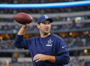 Injured Dallas Cowboys quarterback Tony Romo tosses a football prior to the team's NFL football game against the Seattle Seahawks in Arlington, Texas. (AP Photo/Brandon Wade, File)