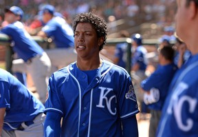 Kansas City Royals shortstop Raul Mondesi (27) looks on form the dugout during the sixth inning against the Texas Rangers at Surprise Stadium. (Jake Roth/USA TODAY Sports)