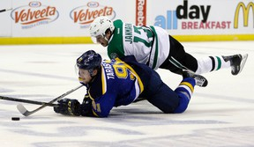 St. Louis Blues' Vladimir Tarasenko and Dallas Stars' Mattias Janmark fall as they chase after a loose puck during the second period of Game 6 of the NHL Western Conference semifinals in St. Louis on May 9, 2016. (AP Photo/Jeff Roberson)