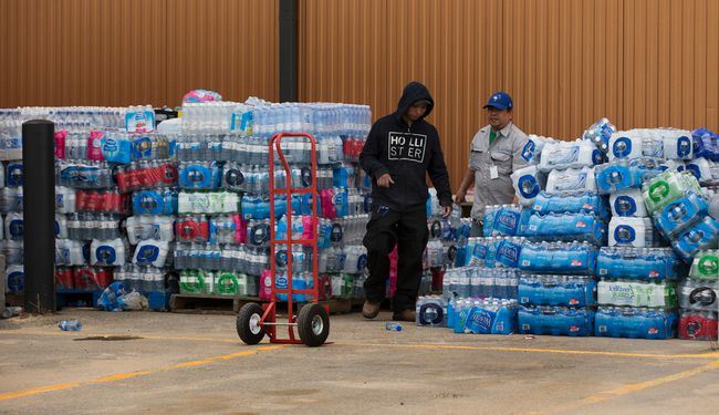Workers move flats of water on May 8, 2016 that have been donated to help residents of Fort McMurray that were forced to evacuate that city and come to the Bold Center in Lac La Biche .  Greg Southam-Postmedia Network