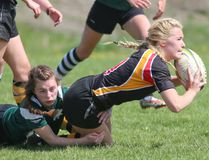 OSCVI Falcons' Alyssa Lozon, right, gets tackled to the ground by Grey Highlands Lions' scrum half Natalie Franks during the Falcons win on Friday in Bluewater Athletic Association girls rugby action at Victoria Park on Friday, May 13, 2016 in Owen Sound, Ont.
