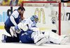 Tampa Bay Lightning head trainer Tom Mulligan (left) tends to goalie Ben Bishop after he was hurt against the Pittsburgh Penguins during Game 1 of the Eastern Conference final Friday at the CONSOL Energy Center. (Charles LeClaire/USA TODAY Sports)