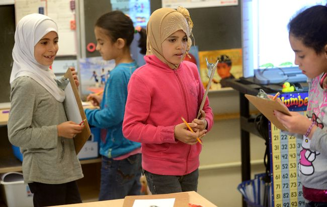Former Syrian refugee students Shaimaa Alsis, Nikar Khaled, Sidra Alshalabi, and Maram Aalloulou, l-r,  in a grade 3-4 class at Eagle Heights Public School in London, Ontario on Friday May 13, 2016. (MORRIS LAMONT, The London Free Press)