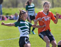 Mimi Gratton of the St. John's Eagles tries to fend off Mila Gretzky of the North Park Trojans during a high school girls soccer match on Monday May 16, 2016 at John Wright Field in Brantford, Ontario. Brian Thompson/Brantford Expositor/Postmedia Network