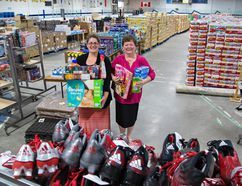 <p>Warehouse co-ordinator Jaimie O'Krafka (left) and Brant United Way executive director Sherry Haines show some of the items on Monday which will be available for purchase in the annual giant warehouse sale, which takes place Saturday, May 28th at Lions Park Arena in Brantford. Brian Thompson/Brantford Expositor