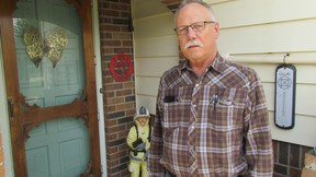 Ron Hayward, standing by his front door on Tuesday May 17, 2016 in Brigden, Ont., says he's stepping down after 44 years with the St. Clair Township community's volunteer fire department. Hayward served as the fire chief in Bridgen for 20 years, until 2003. (Paul Morden, The Observer)