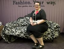Alternative seamstress Laura Lee Hubbard sits on a couch inside The Naughty Gypsy Studio, a custom clothing boutique inside The Renegade at 232 Dundas St. (CRAIG GLOVER, The London Free Press)