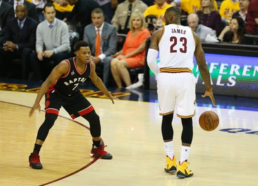 Toronto Raptors Kyle Lowry (7) guards Cleveland Cavaliers LeBron James (23) in the first quarter in Cleveland on Tuesday May 17, 2016. Jack Boland/Toronto Sun/Postmedia Network