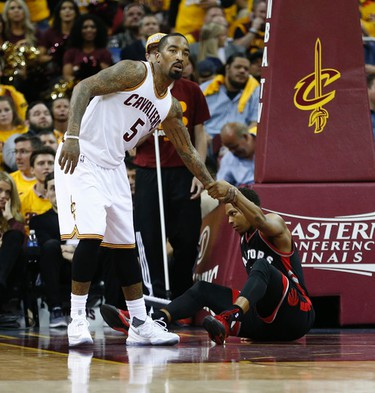 Cleveland Cavaliers J.R. Smith (5) helps up Toronto Raptors Kyle Lowry (7) after he was fouled with a non-foul call in the third quarter in Cleveland on Wednesday May 18, 2016. Jack Boland/Toronto Sun/Postmedia Network