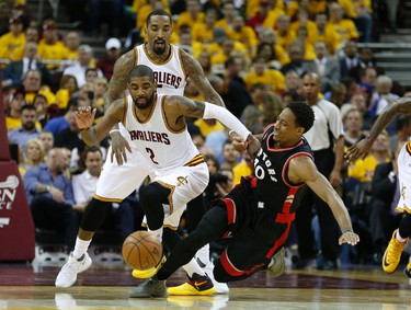 Toronto Raptors DeMar DeRozan (10) loses the ball to Cleveland Cavaliers Kyrie Irving (2) in the third quarter in Cleveland on Wednesday May 18, 2016. Jack Boland/Toronto Sun/Postmedia Network
