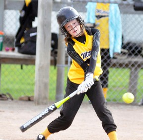 Ashtyn Wedow of the Mitchell Squirt #1 team reaches down to belt this double as the Hornets dumped Londesborough 10-6 last Monday, May 9. ANDY BADER MITCHELL ADVOCATE