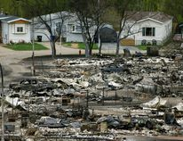 Homes in Fort McMurray are seen last Wednesday after the massive wildfire that forced the evacuation of Alberta's fourth largest city. Fort Mac businesses are struggling to cope. Photo by Larry Wong, Postmedia Network.
