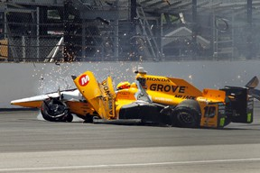 The car driven by Spencer Pigot slides along the track after hitting the wall in the first turn during a practice session for the Indianapolis 500 auto race at Indianapolis Motor Speedway in Indianapolis, Wednesday, May 18, 2016. (AP Photo/Tom Hemmer)