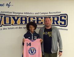 Danielle Reid of Brooklin, Ont., poses with Laurentian Voyageurs women's basketball head coach Jason Hurley. Reid has committed to Laurentian and the women's basketball program for next year. Supplied photo