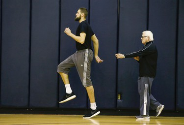 Alex McKechnie, assistant coach/Director of Sports Science works out with Jonas Valiciunas during practice day at the Quicken Loans Arena before Game 2 Thursday night at 8:30 p.m. in Cleveland on Wednesday May 18, 2016. Jack Boland/Toronto Sun/Postmedia Network