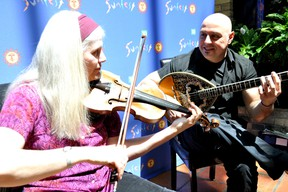 Mary Ashton (left) and Panayiotis Giannarapis, musical directors of The Light of East Ensemble, perform at Aroma Mediterranean Restaurant and Café in London, Ont. May 17, 2016. CHRIS MONTANINI\LONDONER\POSTMEDIA NETWORK